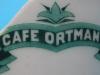 logo na kubku z cukierni Ortmanna